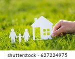 paper cut family with house in... | Shutterstock . vector #627224975