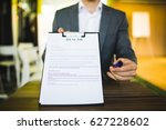 young businessman submitting... | Shutterstock . vector #627228602
