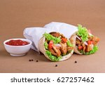 shawarma sandwich with tomato... | Shutterstock . vector #627257462