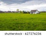spring meadows around a rural...   Shutterstock . vector #627276236