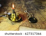 candle lie on old ancient map | Shutterstock . vector #627317366