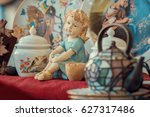 ceramic girl figurine and... | Shutterstock . vector #627317486