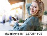 joyful blond girl enjoying... | Shutterstock . vector #627354608