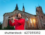 Musician In Red Playing The...