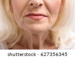 furrowed lips of mature woman | Shutterstock . vector #627356345