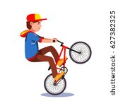 teen kid doing wheelie stunt on ... | Shutterstock .eps vector #627382325