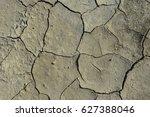 dry soil cracking   | Shutterstock . vector #627388046