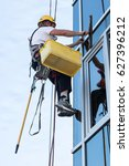 window washer working  at... | Shutterstock . vector #627396212