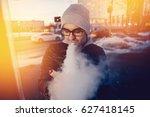vaping man holding a mod device....   Shutterstock . vector #627418145