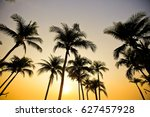 palms on sand beach at sunset  | Shutterstock . vector #627457928