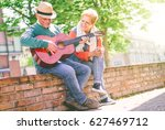 happy senior couple playing a... | Shutterstock . vector #627469712