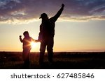 father and son walking on the... | Shutterstock . vector #627485846