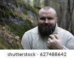 bearded man smokes a pipe in... | Shutterstock . vector #627488642