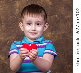the boy is holding a heart | Shutterstock . vector #627557102