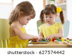 kids girls playing with logical ... | Shutterstock . vector #627574442