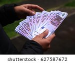 man counting euro notes | Shutterstock . vector #627587672