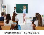 female teacher and schoolboy at ... | Shutterstock . vector #627596378