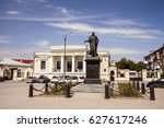 "Small photo of Monument to Emperor Alexander I in the Alexander square in the city of Taganrog, Rostov region. On the background of the building with the inscription ""NATIONAL BANK"""