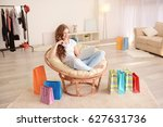 young woman shopping online... | Shutterstock . vector #627631736