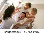 cheerful family playing... | Shutterstock . vector #627651902