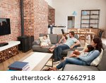 family sit on sofa in open plan ... | Shutterstock . vector #627662918