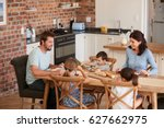 family eating meal in open plan ... | Shutterstock . vector #627662975