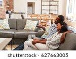 couple sit on sofa in open plan ... | Shutterstock . vector #627663005