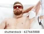 young man receiving laser skin... | Shutterstock . vector #627665888