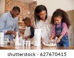 Parents And Children Baking...