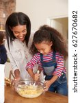 mother and daughter baking... | Shutterstock . vector #627670682
