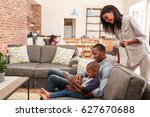 father and son sit on sofa in... | Shutterstock . vector #627670688