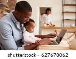 father and baby daughter use... | Shutterstock . vector #627678062