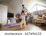 father having game of tag with... | Shutterstock . vector #627696125