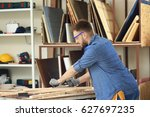 handsome young carpenter in... | Shutterstock . vector #627697235