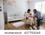 parents sitting in nursery with ... | Shutterstock . vector #627703265