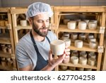 Handsome cheese maker checking...