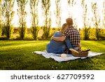 shot of a happy couple enjoying ... | Shutterstock . vector #627709592