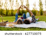 happy couple in love  lying on... | Shutterstock . vector #627710075