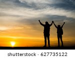 silhouettes of two hikers with... | Shutterstock . vector #627735122