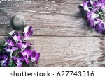 orchid flower on old wood... | Shutterstock . vector #627743516