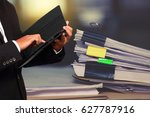 businessman holding tablet in...