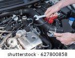 hands of car mechanic repairing ... | Shutterstock . vector #627800858