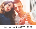 young loving couple with small... | Shutterstock . vector #627812222