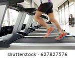 man running on treadmill in gym.   Shutterstock . vector #627827576