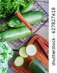 fresh green zucchini in a metal ... | Shutterstock . vector #627827618