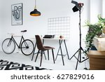 modern home workspace with lamp ... | Shutterstock . vector #627829016