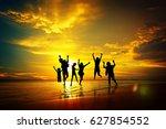 silhouette of people cheering... | Shutterstock . vector #627854552