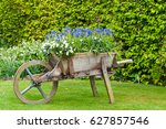 rustic wooden wheelbarrow... | Shutterstock . vector #627857546