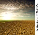 plowed field in spring time... | Shutterstock . vector #627866336