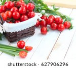 fresh cherry tomatoes and greens | Shutterstock . vector #627906296